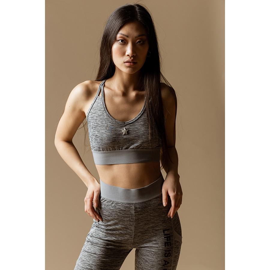 Top gym donna dettaglio a strappo sul dorso stella marsc grigio melange